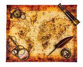 Vintage magnifying glass, compass, goose quill pen, spyglass and a pocket watch lying on an old map