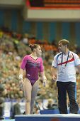 MOSCOW, RUSSIA - APRIL 20: Aliya Mustafina, Russia and her coach after the exercise on uneven bars in final of 5th European Championships in Artistic Gymnastics in Moscow, Russia on April 20, 2013