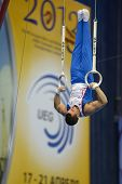 MOSCOW, RUSSIA - APRIL 20: Samir Ait Said, France performs exercise on still rings in final of 5th European Championships in Artistic Gymnastics in Moscow, Russia on April 20, 2013