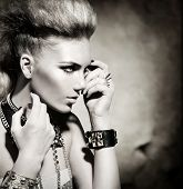 Fashion Rocker Style Model Girl Portrait. Hairstyle. Rocker or Punk Woman Makeup and Hairdo. Black and White Portrait of Glamour and Stylish Young Woman