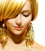 Beauty Blonde Fashion Model Girl With Golden Earrings. Beautiful Blond Hair. Skincare concept