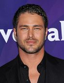 LOS ANGELES - APR 22:  Taylor Kinney arrives to the NBC Universal Summer Press Day 2013  on April 22