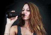 Drunk Woman Drinking Beer Over Black