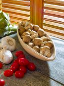 foto of crimini mushroom  - Crimini mushrooms with cherry tomatoes & garlic by kitchen window