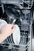Hand Takes Plate From Dishwasher