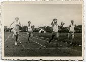 RAWICZ, POLAND, CIRCA 1939 - Vintage photo of unidentified boys running during a sport event, Rawicz