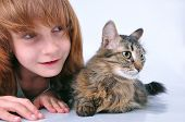 Child And Cat Looking With Surprise