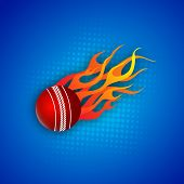 Cricket ball in fire on abstract blue background.