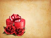 Vintage holiday background with red roses and a gift box. Vector.