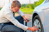 Businessman Pumps Car Tire Pump