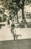 STARACHOWICE, POLAND, CIRCA 1954: vintage photo of little boy on bicycle, Starachowice, Poland, circ