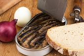 sprats in a tin with red onion boiled egg black bread and opener