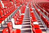 image of bleachers  - Red chairs bleachers in large stadium - JPG
