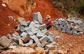 Worker Split Stone For Road-works