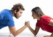 stock photo of wrestling  - Arm wrestling challenge between a young couple - JPG