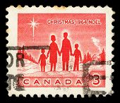 CANADA - CIRCA 1964: A Christmas stamp printed in Canada shows Family and Star of Bethlehem, circa 1