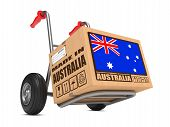 stock photo of free-trade  - Cardboard Box with Flag of Australia and Made in Australia Slogan on Hand Truck White Background - JPG