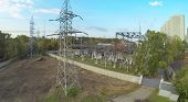 Power station and power lines at day. View from unmanned quadrocopter.