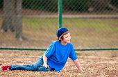 Cute Boy Sitting On Grass