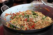 stock photo of noodles  - Preparation of spicy thai noodles in an asian restaurant - JPG