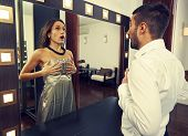 stock photo of transvestite  - frightened man looking at woman in the mirror - JPG