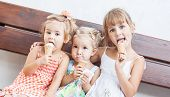 Funny Children Girls Eating Ice Cream
