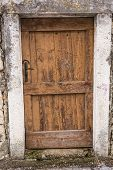 Old Wooden Door In A Wall