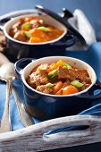 pic of stew pot  - beef stew with potato and carrot in blue pots  - JPG
