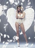 Photo Of Sexy Blonde Woman With Long Hair Wearing Angel's Wings. Beautiful Body.