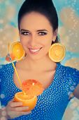 Girl with Orange Drink and Orange Slice Earrings