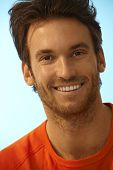 Portrait of happy handsome casual caucasian man. Smiling, perfect teeth, stubble.