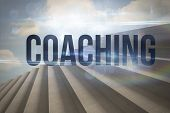 The word coaching against steps against blue sky