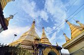 YANGON - OCT 12: The exterior of Sule Pagoda in the city center on October 12, 2013 in Yangon, Burma