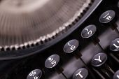 picture of qwerty  - Close up photo of antique typewriter keys shallow focus natural colors - JPG