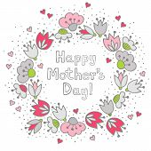Messy different colorful pink gray flowers and hearts in round wreath on white Mother's Day card
