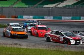 SEPANG, MALAYSIA - MAY 10, 2014: Production saloon class cars take to the track at the Thailand Supe