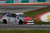 SEPANG, MALAYSIA - MAY 10, 2014: The Toyota Altis car of Chen Jian Hong takes to the track at the Th