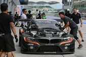 SEPANG, MALAYSIA - MAY 10, 2014: The BMW car of Morris Chen and Tatsuya Tanigawa returns to the pit