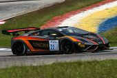SEPANG, MALAYSIA - MAY 10, 2014: The Lamborghini LP600 car of Sanchai Engtrakul takes to the track a