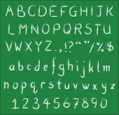 foto of punctuation  - White chalk handwritten alphabets numbers and common punctuation on green black board - JPG