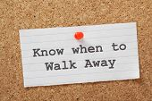picture of board-walk  - The phrase Know When to Walk Away on a paper note pinned to a cork notice board - JPG