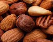 stock photo of pecan nut  - Background texture of assorted mixed nuts including cashew nuts, pecan nuts, almonds ** Note: Shallow depth of field - JPG