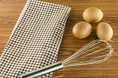 Whisk Egg And Brown Kitchen Towel