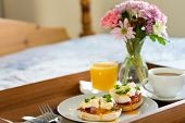 Eggs Benedict On Breakfast Tray On Bed