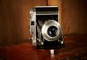 Old vintage film camera on wooden background