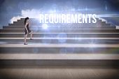 The word requirements and businesswoman stepping up steps against blue sky