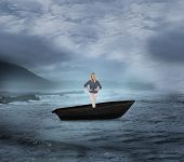 Composite image of thoughtful gorgeous blonde in a sailboat on open water
