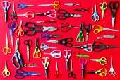 Display Of Multiple Scissors On Red