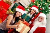 picture of santa claus hat  - Santa Claus giving presents to some girls - JPG