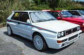 White Lancia Delta Rally Car